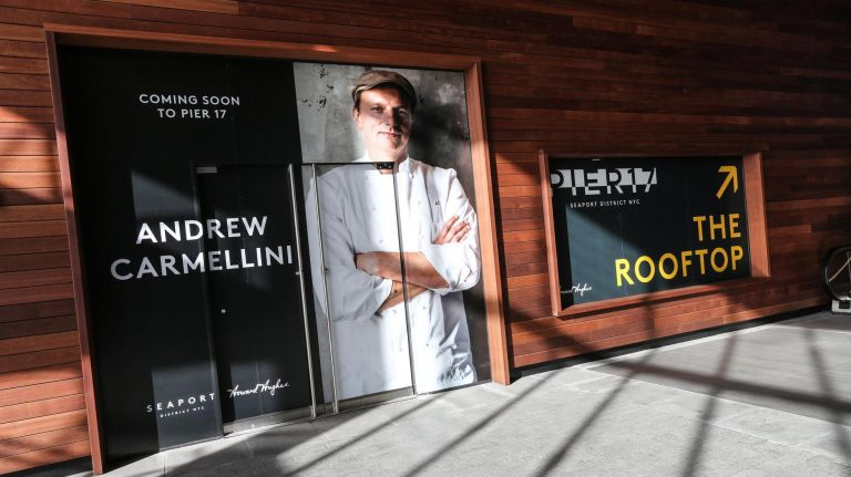Signage in the lobby at Pier 17 at the South Street Seaport announces a future restaurant from chef Andrew Carmellini.