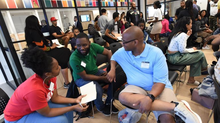 StartupBus participants met at the JPMorgan Chase Harlem branch Wednesday before boarding the bus for the five-day competition.