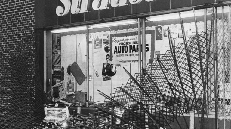 During the blackout on July 14, 1977, a Strauss Store on Liberty Avenue in Jamaica, Queens, had its metal curtain ripped down by looters.