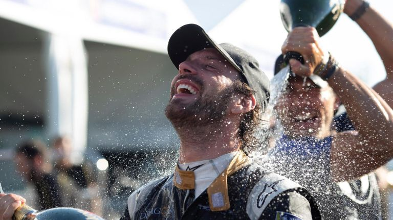 Jean-Éric Vergne celebrates his Championship win on July 15, 2018, in Red Hook.