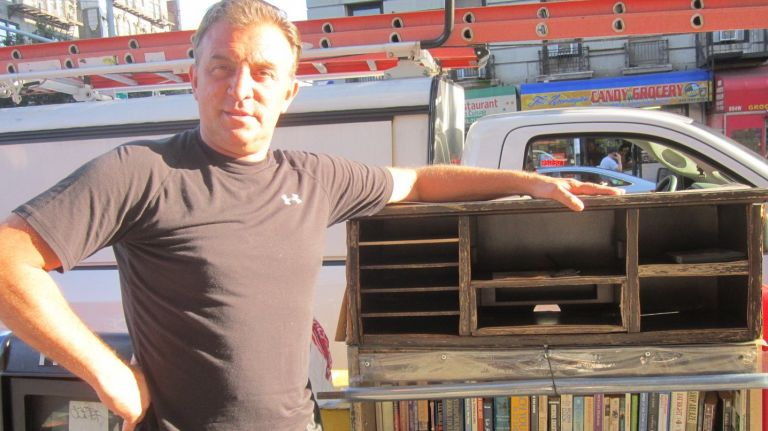Kevin Klepper voluntarily installs and maintains public bookshelveson the streets of Washington Heights and Inwood.