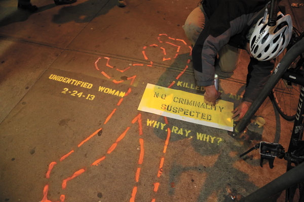 Late last Thursday night, a bicycle activist stenciled at Third Ave. and 27th St. where, on Feb. 24, a still-unidentified pedestrian was killed after a car and cab collided, sending the car jumping the curb onto the sidewalk.  Photo by Jefferson Siegel