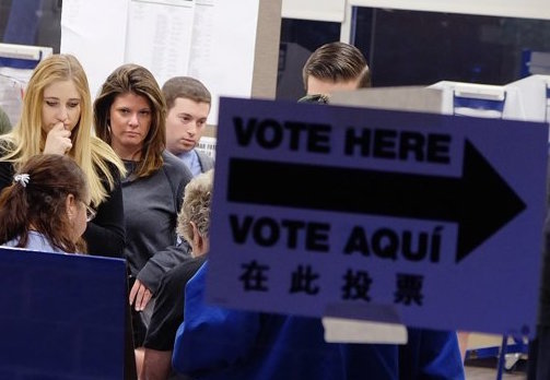 Lower Manhattan residents being checked in by election workers at a Southbridge Towers poll site during this past April's 65th Assembly District special election. Villager file photo