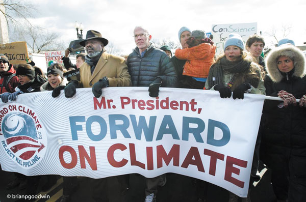 Photo by Brian Goodwin Bill McKibben, founder of 350.org, in black down jacket, center, led the march at Sunday's rally on climate change in D.C.