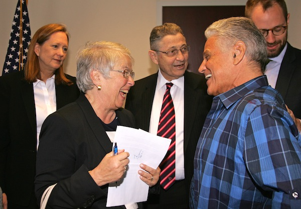 Schools Chancellor Carmen Fariña, left shared a laugh with Community Board 1's Paul Hovitz before last Thursday's meeting on Lower Manhattan schools, but the Downtown advocates were hoping for some answers from Fariña. Behind them were Catherine McVay Hughes, C.B. 1's chairperson and Assembly Speaker Sheldon Silver. Downtown Express photo by Sam Spokony.