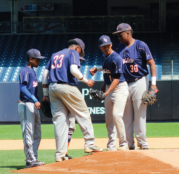 Infielders gathered on the mound with pitcher Timothy Lopez, second from right, at the start of their frame of the first inning against Lehman at Yankee Stadium.