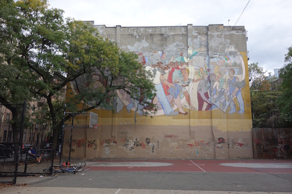The message of Arnold Belkin's 1972 mural endures — and Hell's Kitchen residents are determined to return the faded artwork to its former glory. Courtesy Mathews-Palmer Playground Mural & Arts Program.