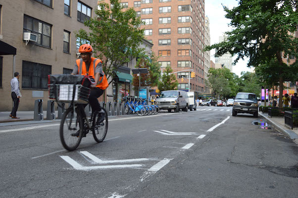 New painted bike lanes are beginning to be installed on the Upper East Side, as here on East 77th Street, between Third and Lexington Avenues. | JACKSON CHEN
