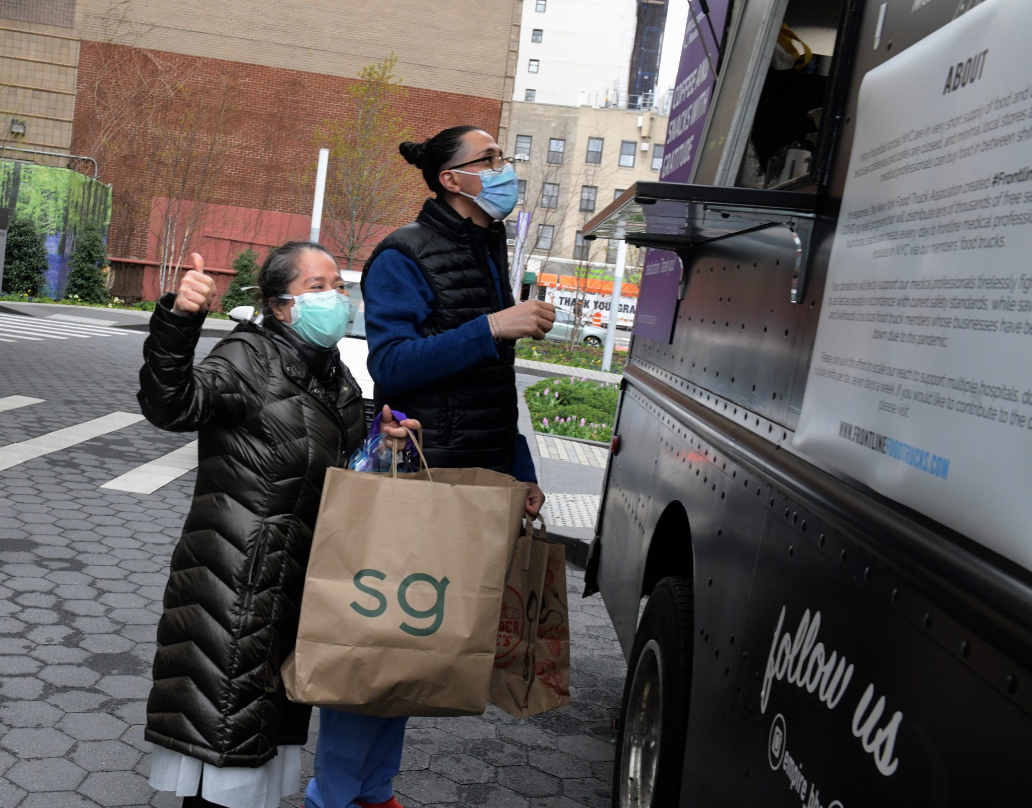 Food trucks park at NYU Langone in Manhattan to provide meals for the staff